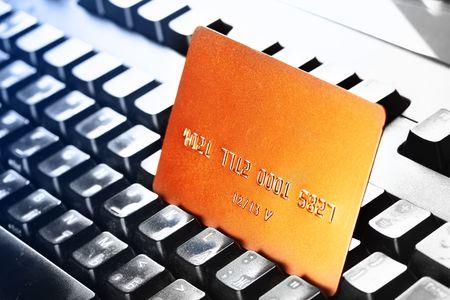 key card: Gold credit card close-up on computer keyboard Stock Photo