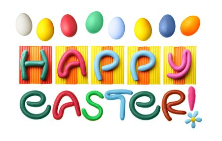 Happy Easter phrase made from plasticine isolated over white background photo