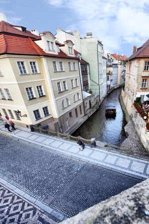 architectural architectonic: Narrow canal and boat at Prague. Czech Republic