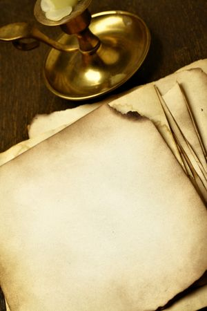 witchery: Old pages close-up and candle on wooden table Stock Photo