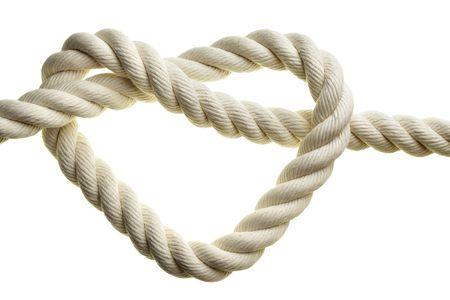 Heart shape rope isolated over white background photo