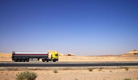 trucker: Large tanker truck drive on highway at desert