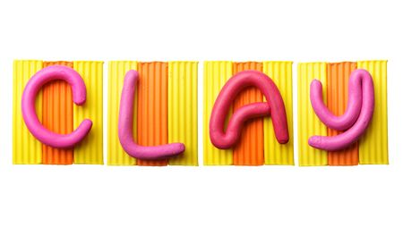 Word CLAY made from plasticine isolated over white background photo
