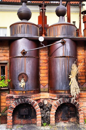 vats: Old brewery - workshop with black steel vats  Stock Photo