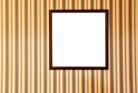 Blank frame on wall with striped wallpaper photo
