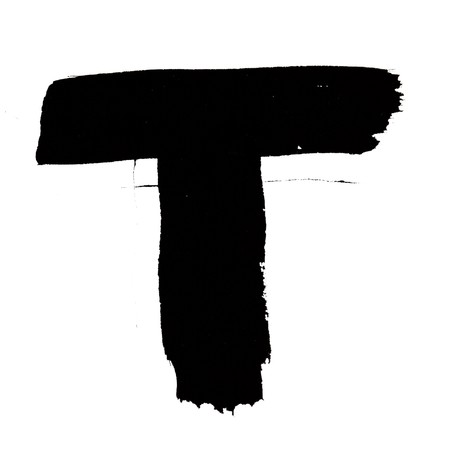 T - Black ink letters isolated over the white background photo