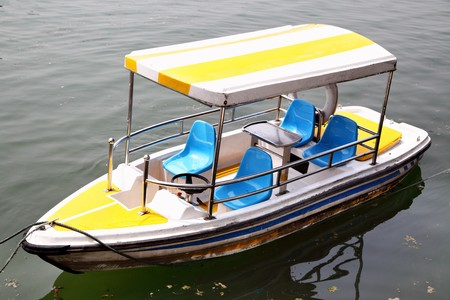 traction: Electric traction recreation boat with awning  close up