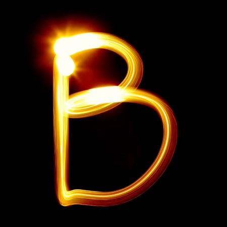 Created by light alphabet over black background photo