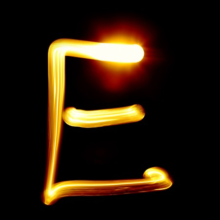 decorative letter: Created by light alphabet over black background