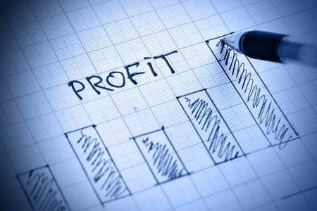 profit: Pen drawing profit bar chart. Shallow DOF! Stock Photo