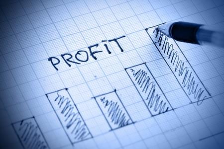 profits chart: Pen drawing profit bar chart. Shallow DOF! Stock Photo
