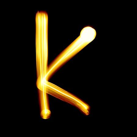 educaton: Created by light alphabet over black background