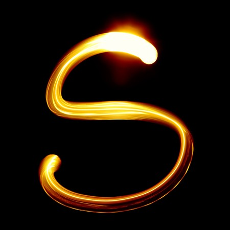 s curve: Created by light alphabet over black background
