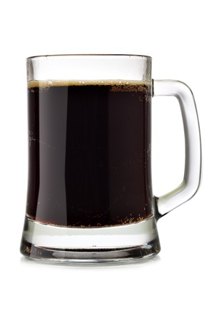 Mug of dark beer isolated over the white background photo