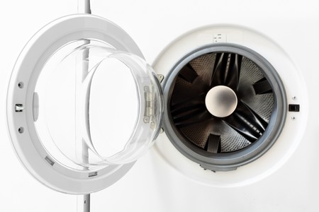 washing up: White washing machine with opened door close-up Stock Photo