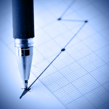 Pen drawing a crisis graph. Shallow DOF! photo