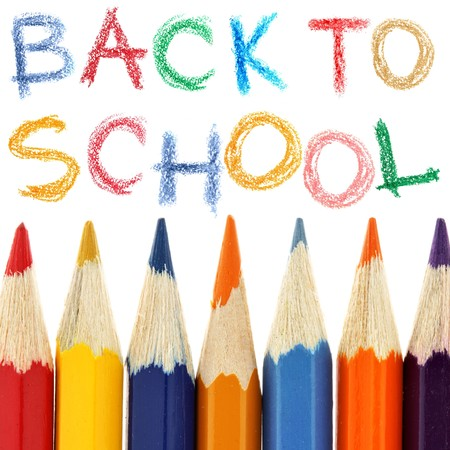 Crayons and back to school text over white background photo