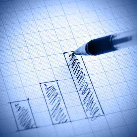 financial report: Pen drawing profit bar chart. Shallow DOF! Stock Photo