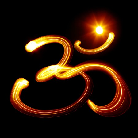 Sacred Om syllable created by light over black background Stock Photo - 7524323