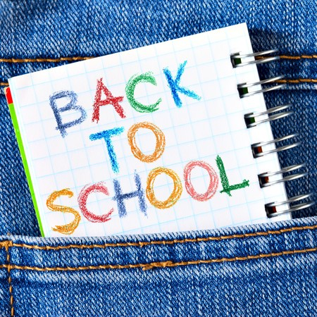 back pocket: Notebook in jeans poket with phrase Back To School