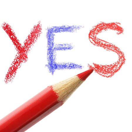 chose: Crayon writing word YES over white background