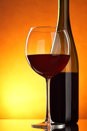 still life of wine: Glass and bottle of red wine close-up