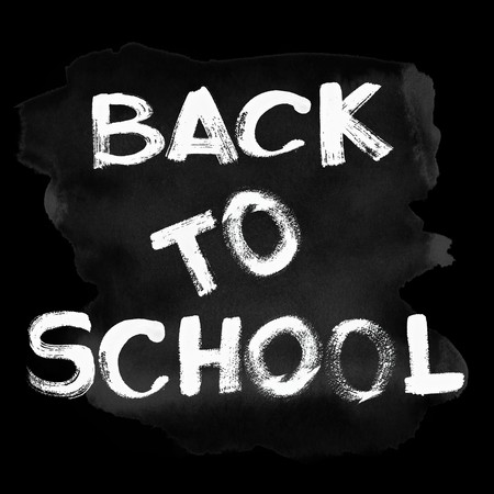 White Back to school text over black chalkboard photo