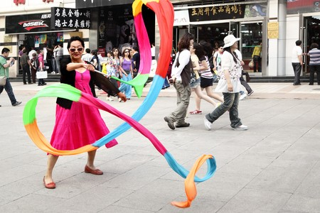 strret: BEIJING - JUNE 2: Street performancer at Wangfujing Dajle street,  June 2, 2010 in Beijing, China. Wangfujing strret is perfect place for shoppng, walking and eating. Editorial