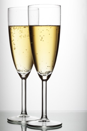 Two glasses of champagne over light gray white background  photo