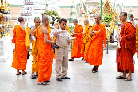 BANGKOK - DECEMBER 11: Buddhist monks on excursion at Wat Phra Kaeo temple, December 11, 2009 in Bangkok, Thailand. In Thailand its a tradition for men to ordain as a monk at least once.