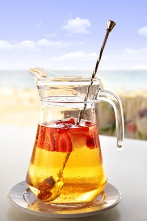 Jug with Champagne Sangria on the cafe table Stock Photo - 7988666