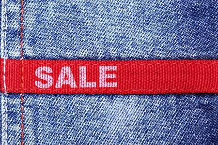 red jeans: Blue jeans with red label and word SALE