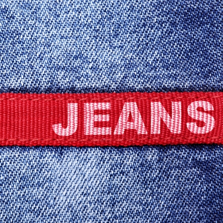 worn jeans: Blue jeans and red label with word  Stock Photo