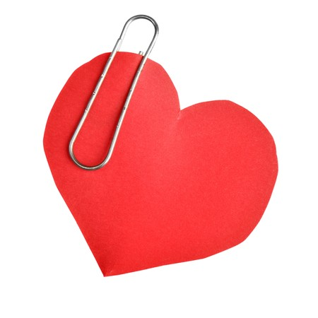Paper red heart with clip isolated over white background  photo