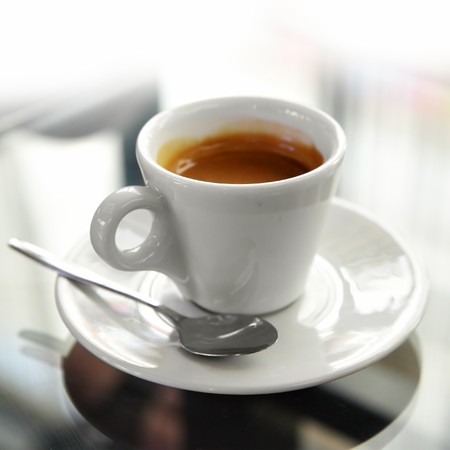 coffe break: Cup of espresso coffee on the table Stock Photo