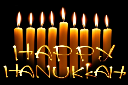 hanukkah: Created by light text Happy Hanukkah and candles over black background