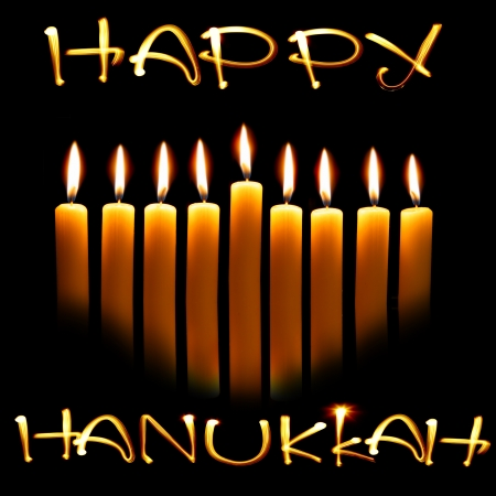 Created by light text Happy Hanukkah and candles over black background photo