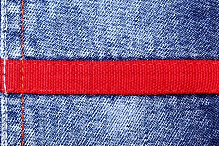 denim texture: Blank red label close-up over jeans background Stock Photo