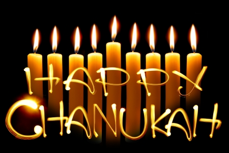 Created by light text Happy Chanukah and candles over black background photo