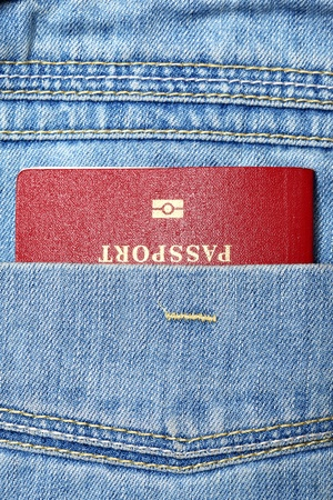 Red biometric passport in jeans pocket close-up Stock Photo - 8335963
