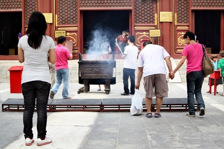 BEIJING - JUNE 1: Prayers at The Lama tample June 1, 2010 in Beijing, China. The Lama Temple built in 1694