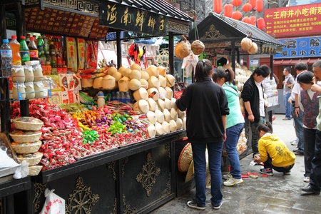 fair woman: BEIJING - JUNE 2: Snack street near Wangfujing Dajle street,  June 2, 2010 in Beijing, China.  Snack strret is perfect place for shoppng, walking and eating