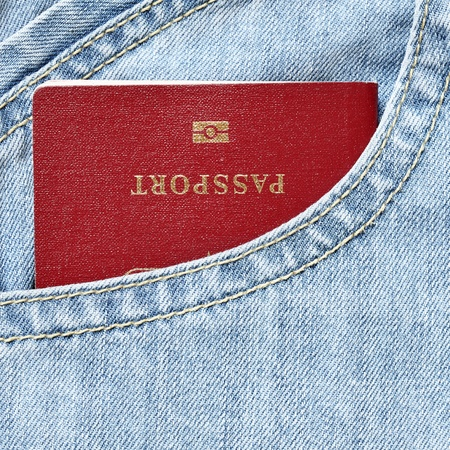 Red biometric passport in jeans pocket close-up Stock Photo - 8374799