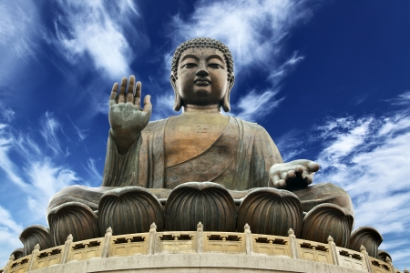 Giant Buddha sitting on lotusl. Hong Kong photo