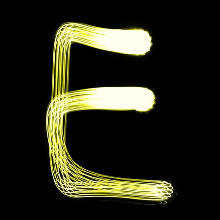 flashlights: E - Created by light alphabet over black background