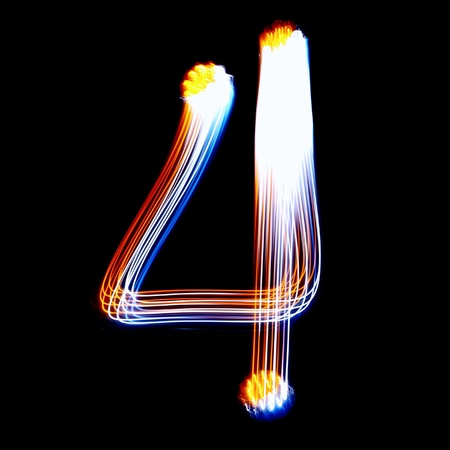 4 - Created by light colorful digits over black background photo