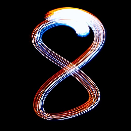 8 - Created by light colorful digits over black background photo