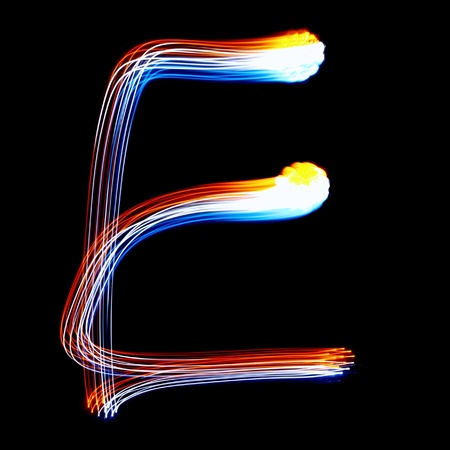 E - Created by light colorful letters over black background photo