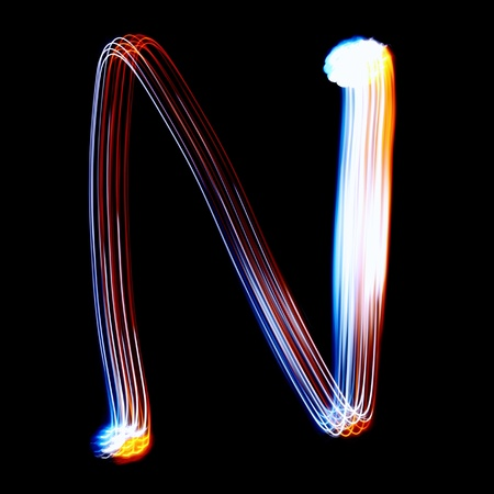pictured: N - Created by light colorful letters over black background