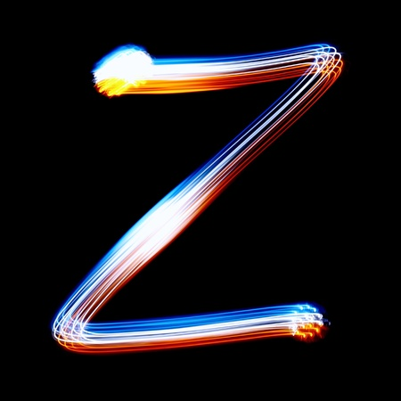 pictured: Z - Created by light colorful letters over black background Stock Photo